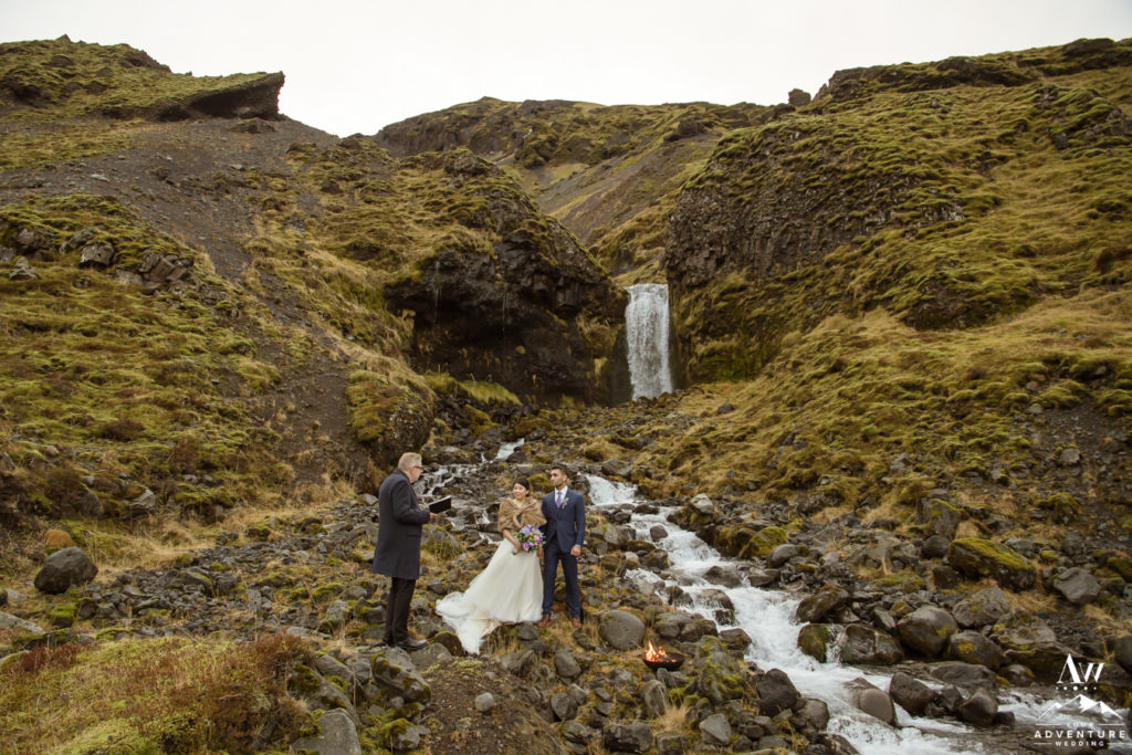 Iceland Elopement couple at a waterfall in December