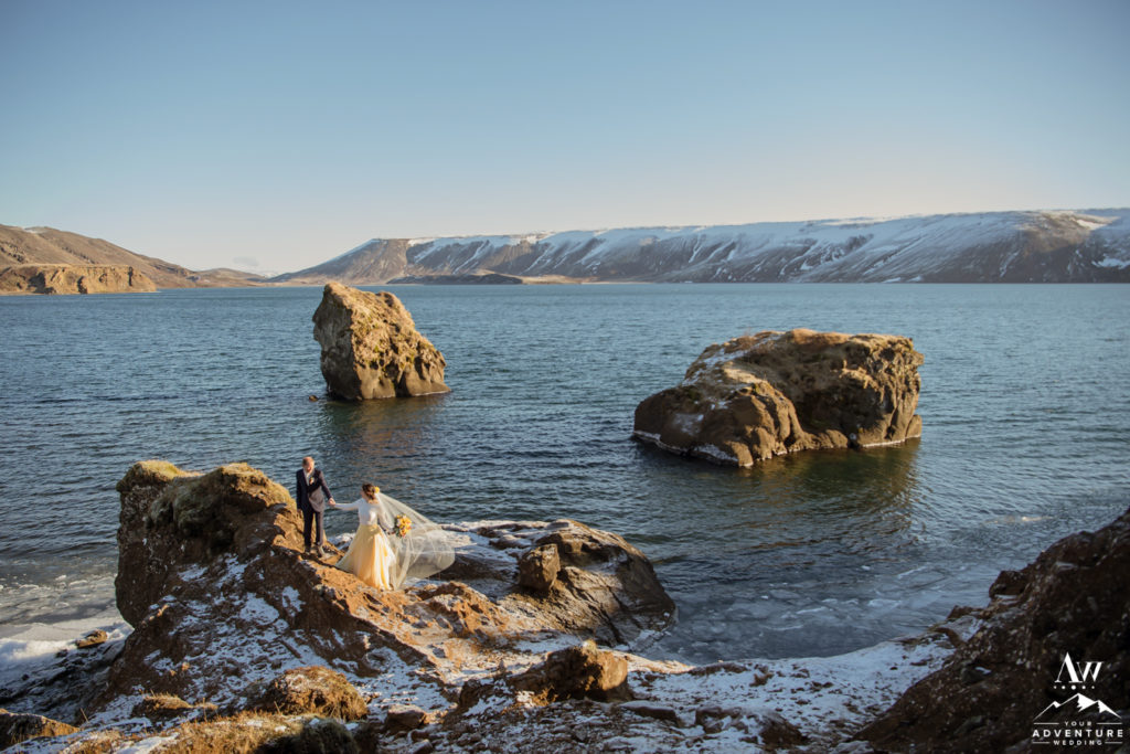 March Elopement in Iceland couple at a lake