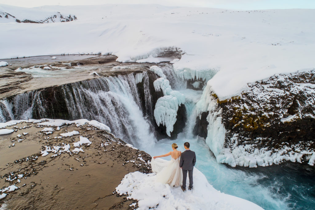 February Elopement in Iceland Couple at a Waterfall
