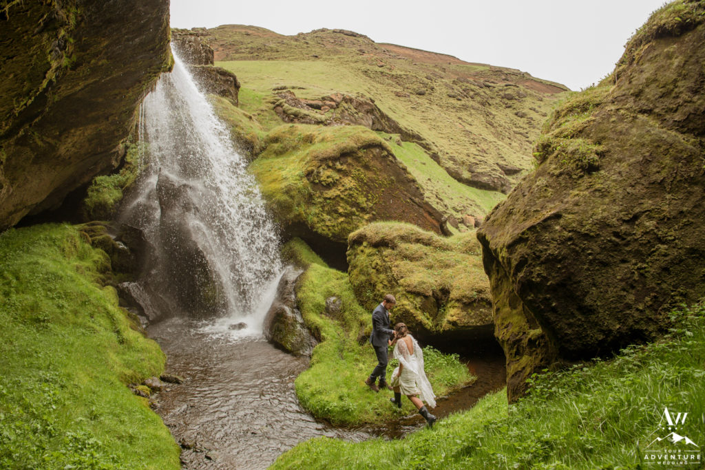 Iceland-Elopement-Photographer-Couple crossing a river together