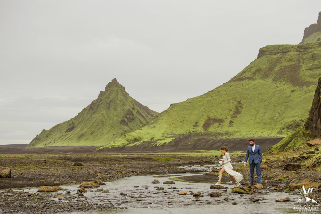 Iceland Elopement Couple Crossing a River
