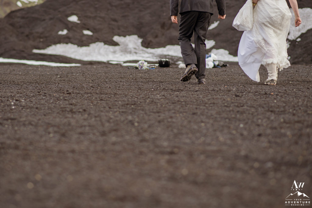 Iceland elopement couple walking to a glacier
