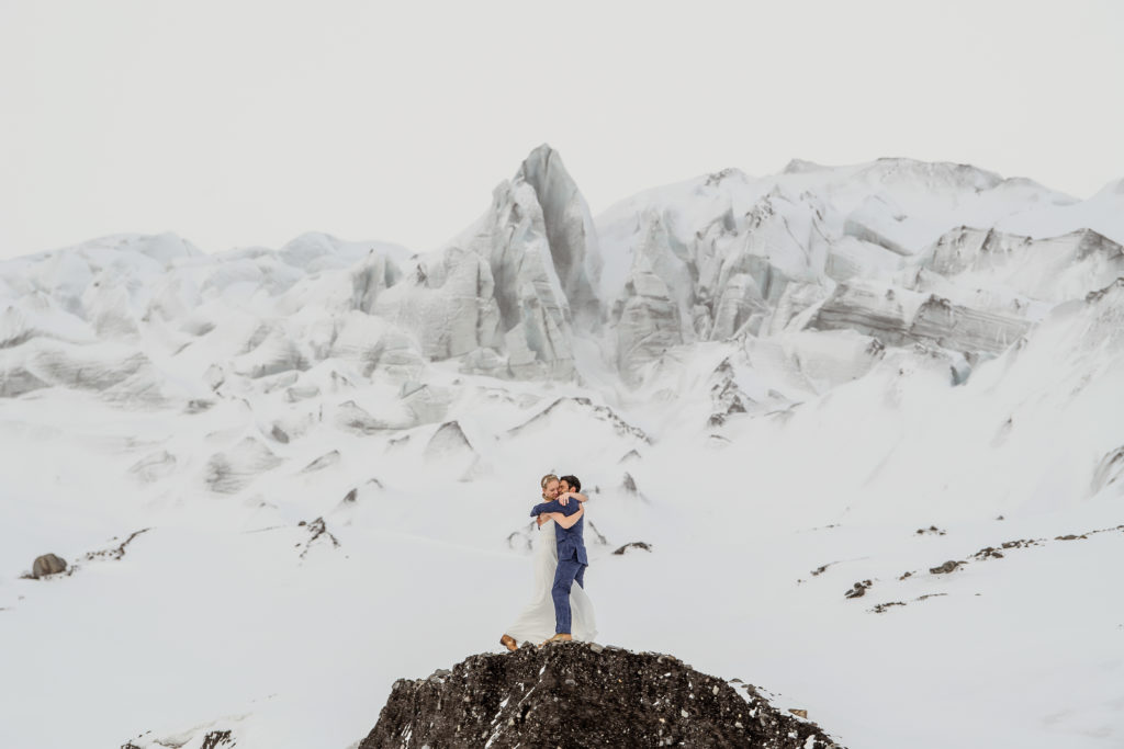 Iceland Wedding Couple hugging in front of a glacier