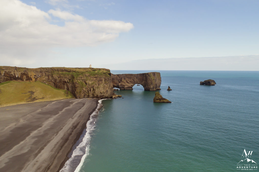 Drone shot of the private side of Dyrhólaey Sea Arch in Iceland