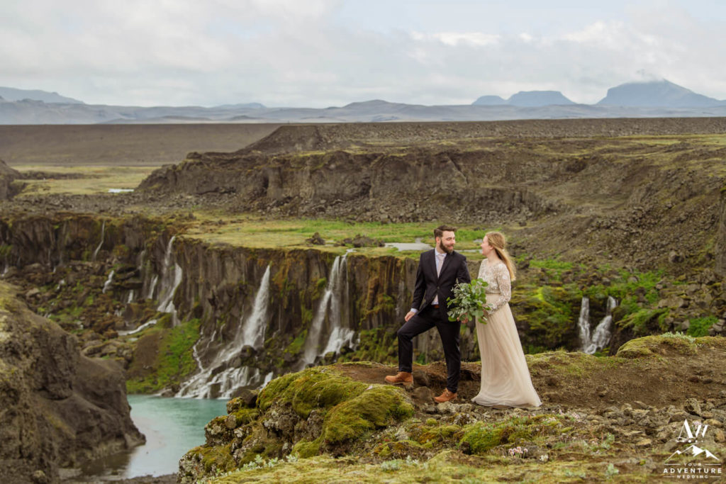 Ethereal Iceland Elopement Couple Standing on a cliff