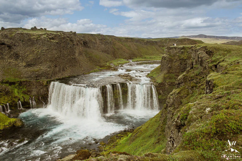 Couple on top of waterfall during Wedding in Icelandic Highlands