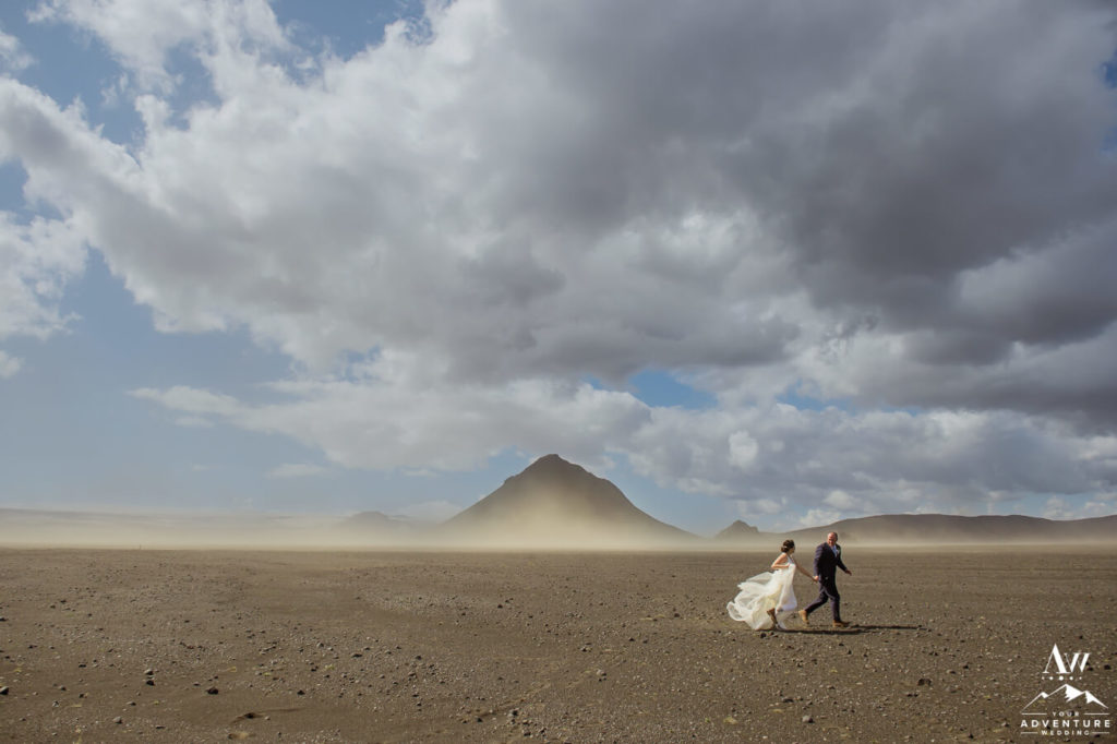 Weather in Iceland- Couple Running in a sand storm