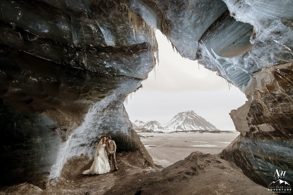 Iceland elopement couple kissing inside of an ice cave