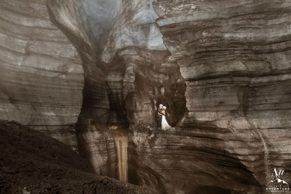 Waterfall Ice Cave Iceland Elopement Couple inside