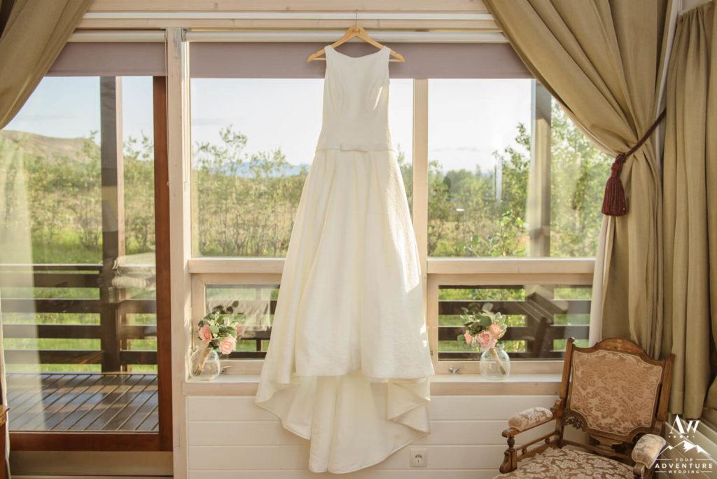 Iceland Wedding Dress Hanging in a window