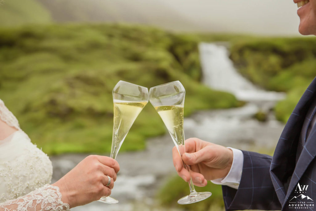 Iceland elopement couple toasting each other