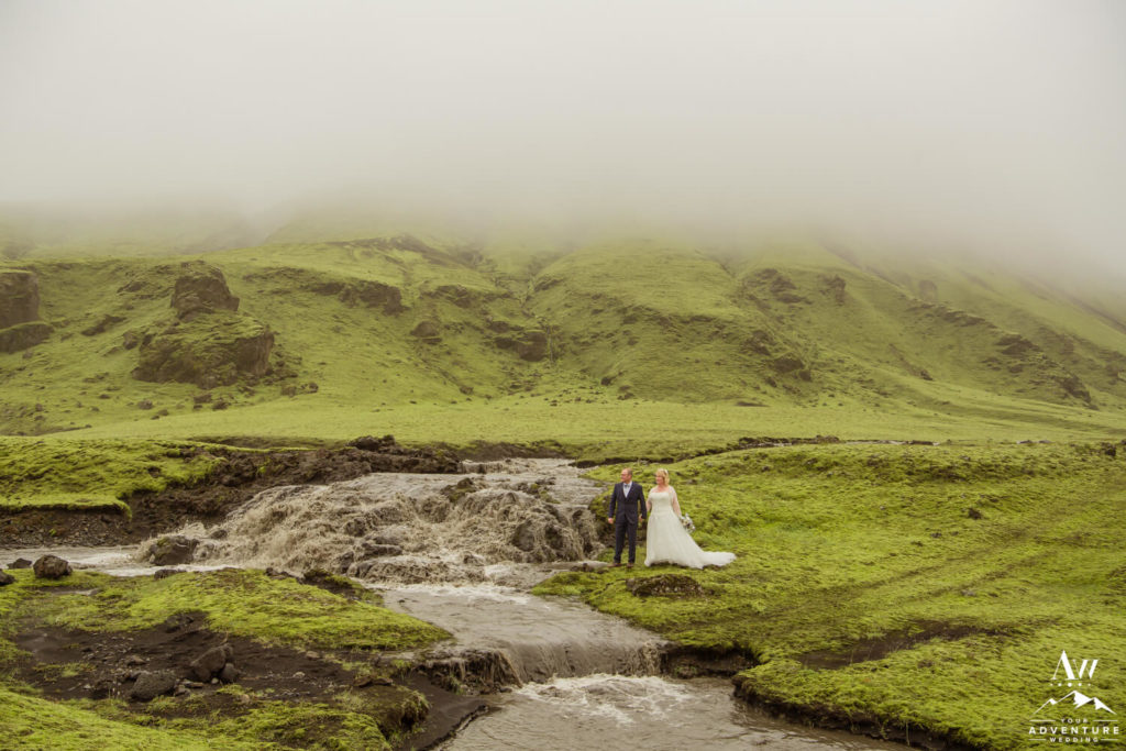 Iceland adventure elopement couple at glacier waterfall