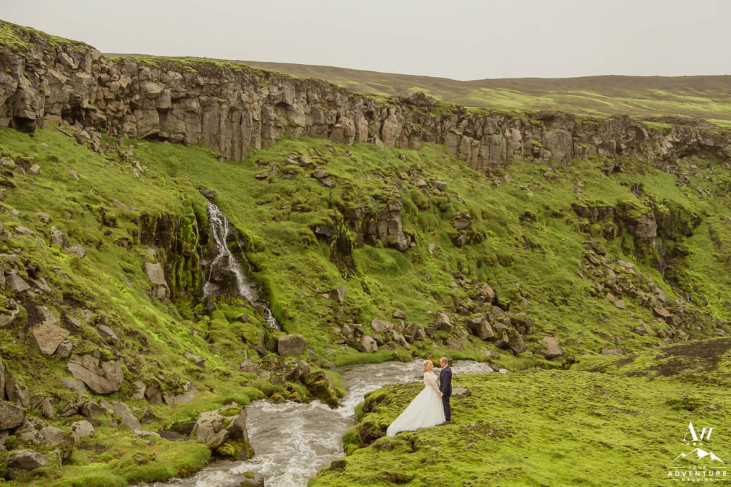 Couple in front of a waterfall during july elopement in Iceland