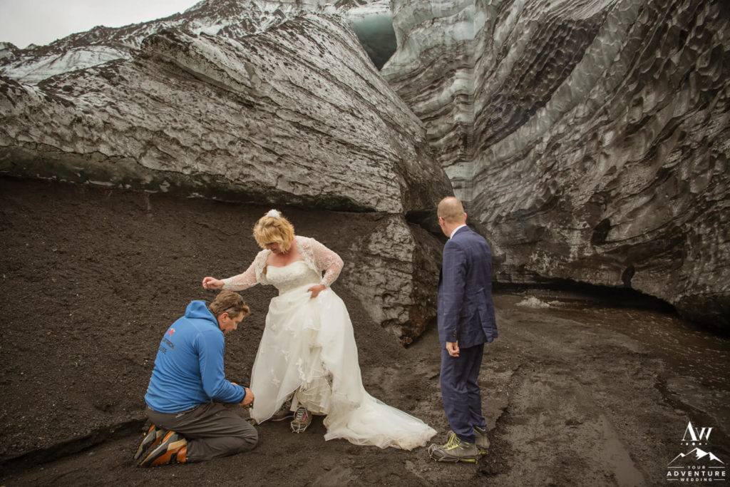 Iceland Elopement Couple Putting on Crampons