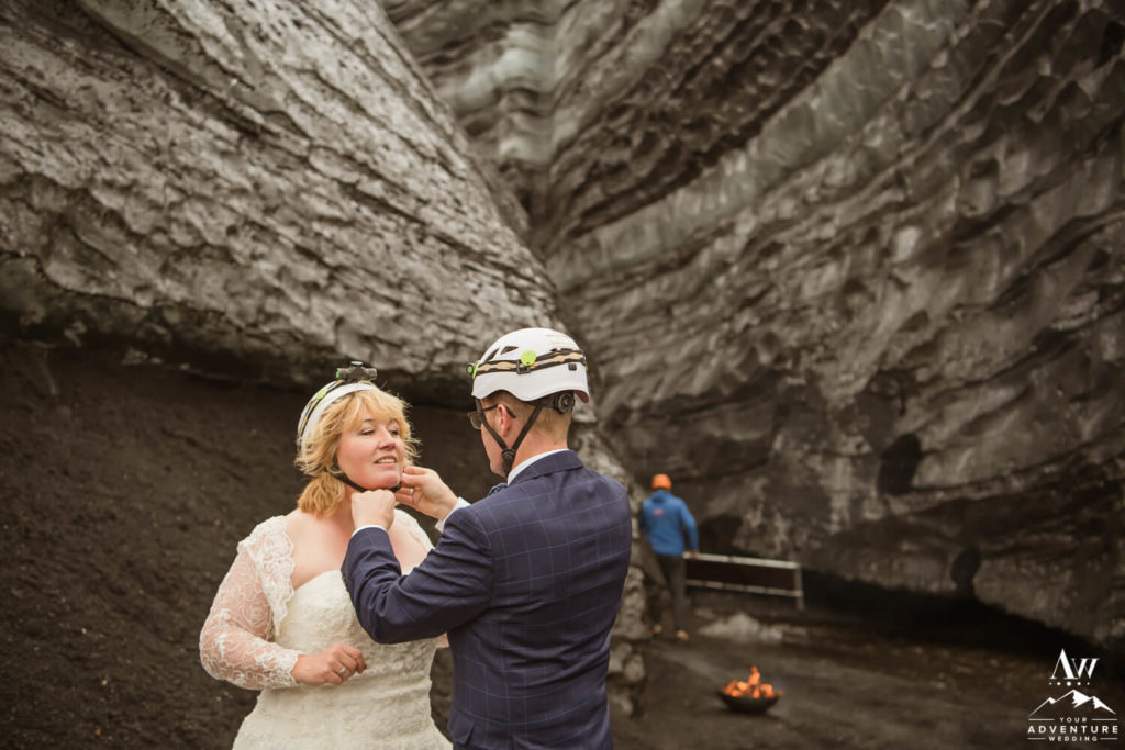 Adventure Elopement Couple putting on helmets