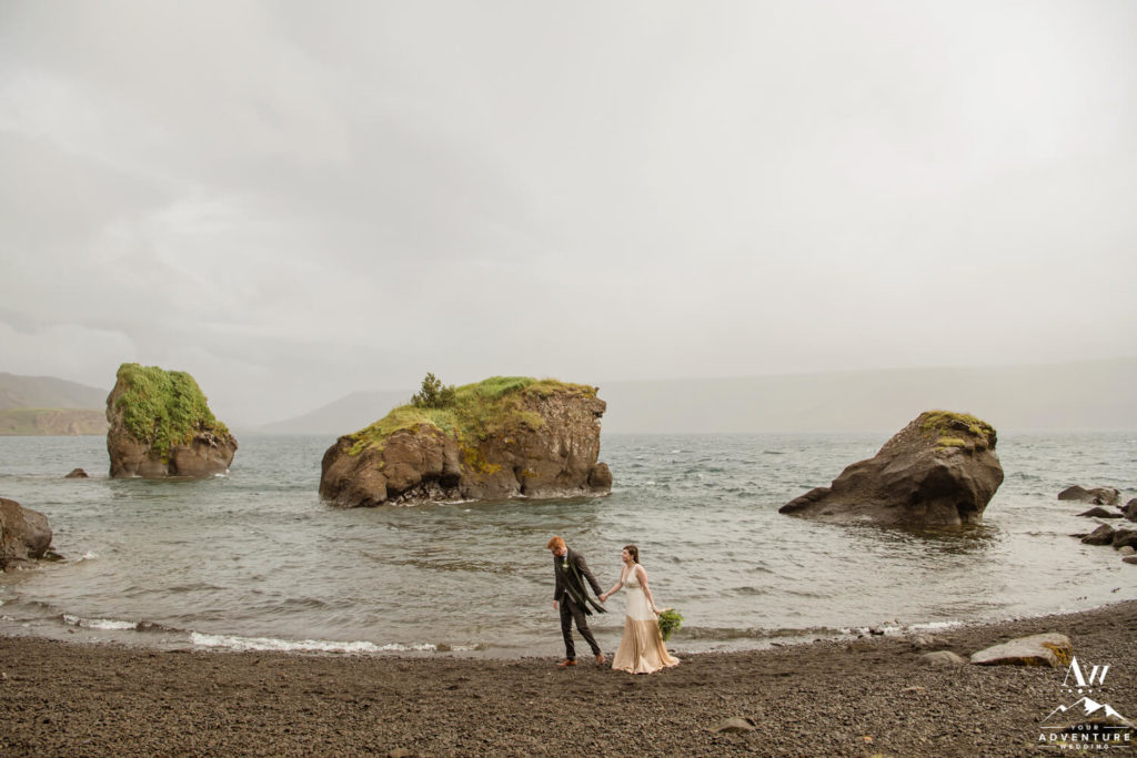 Couple Walking by a lake during Iceland July Wedding