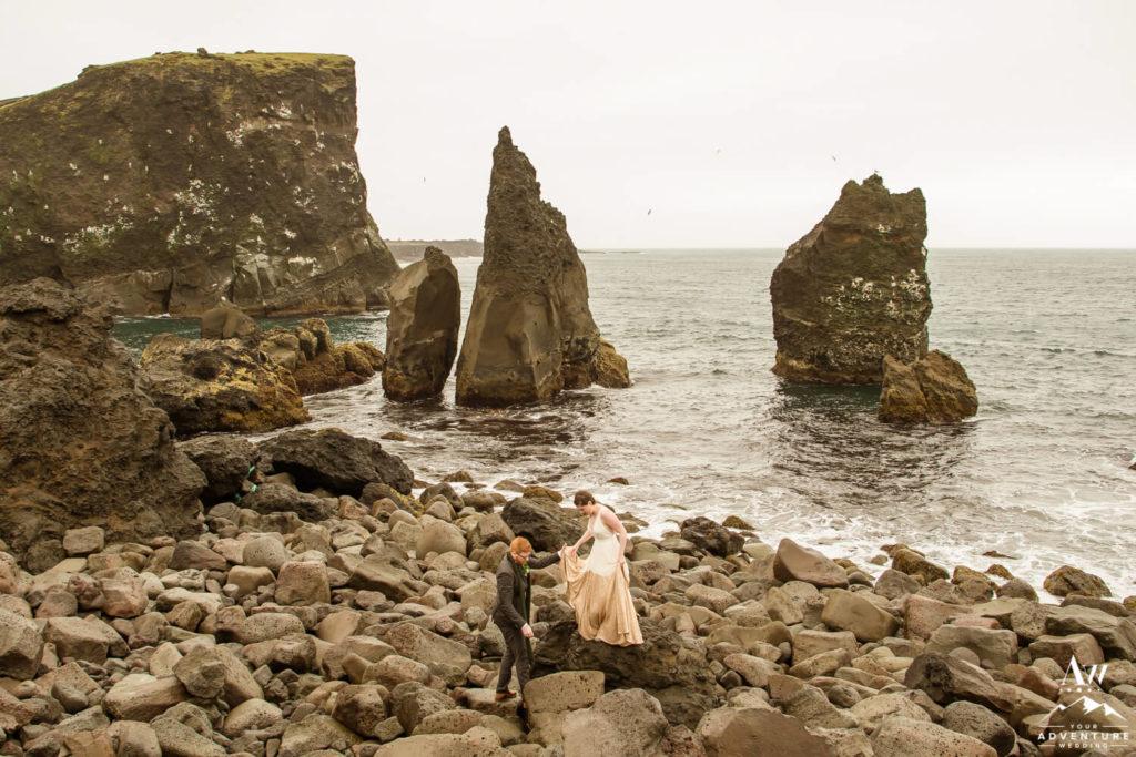 Iceland Elopement Couple exploring Reykjanesviti