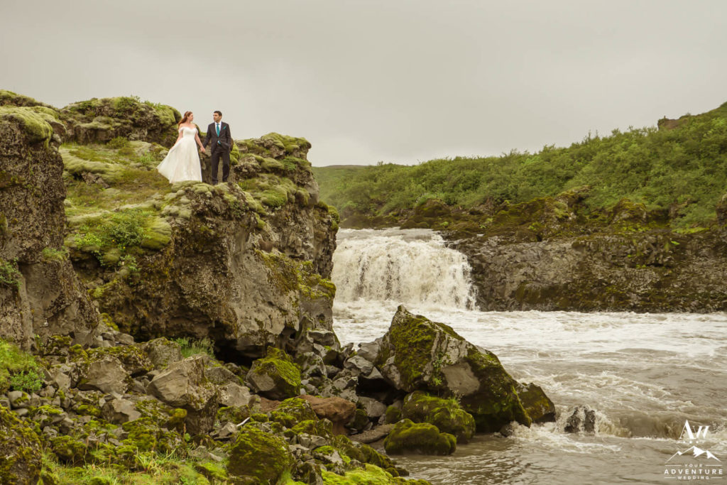 Wedding couple on top of a waterfall