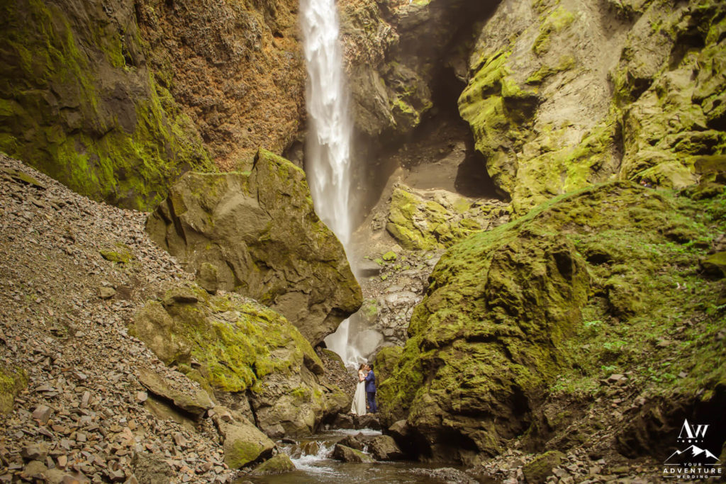Elopement couple in front of a waterfall in Iceland