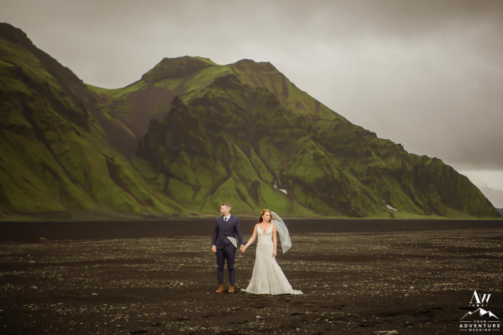 Iceland elopement couple in front of a green mountain
