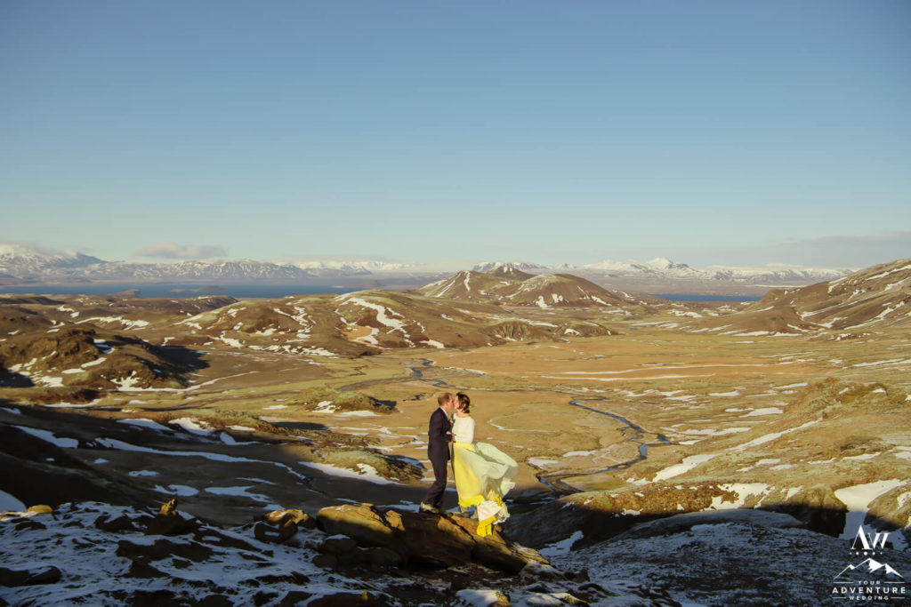 Couple on a mountain in Iceland Yellow dress