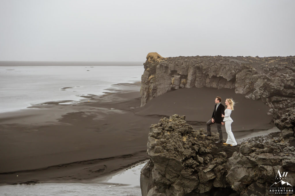 Iceland Wedding Couple Looking out to a black beach