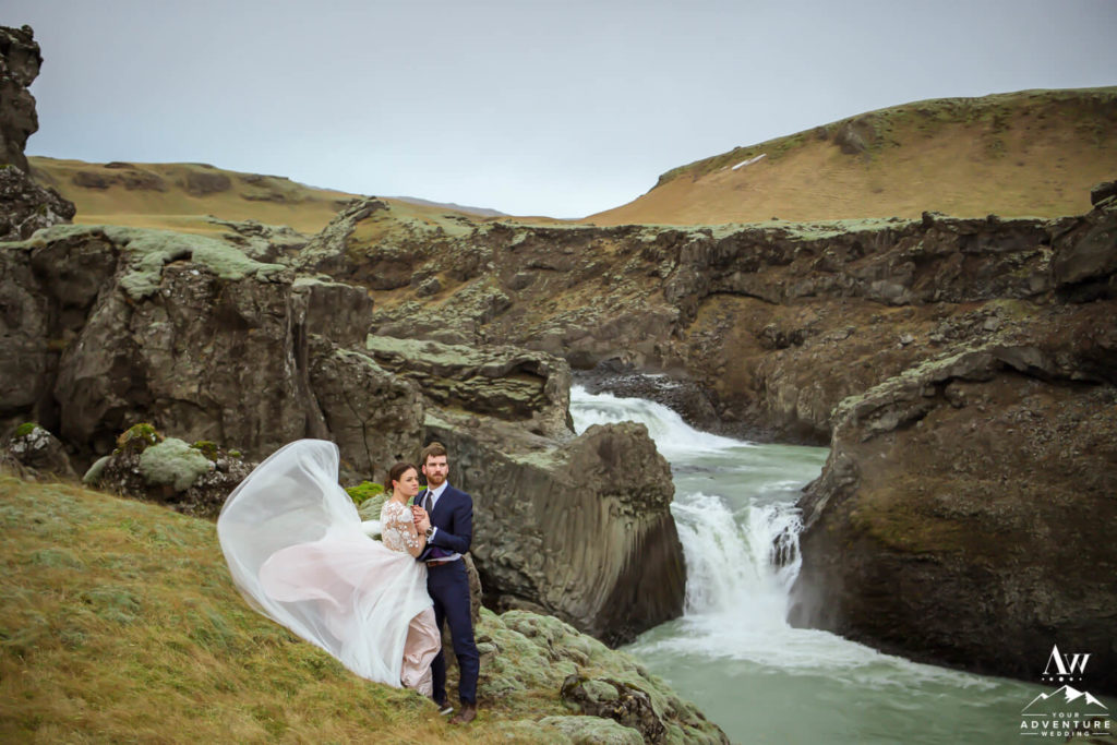 Couple in front of a waterfall in Iceland