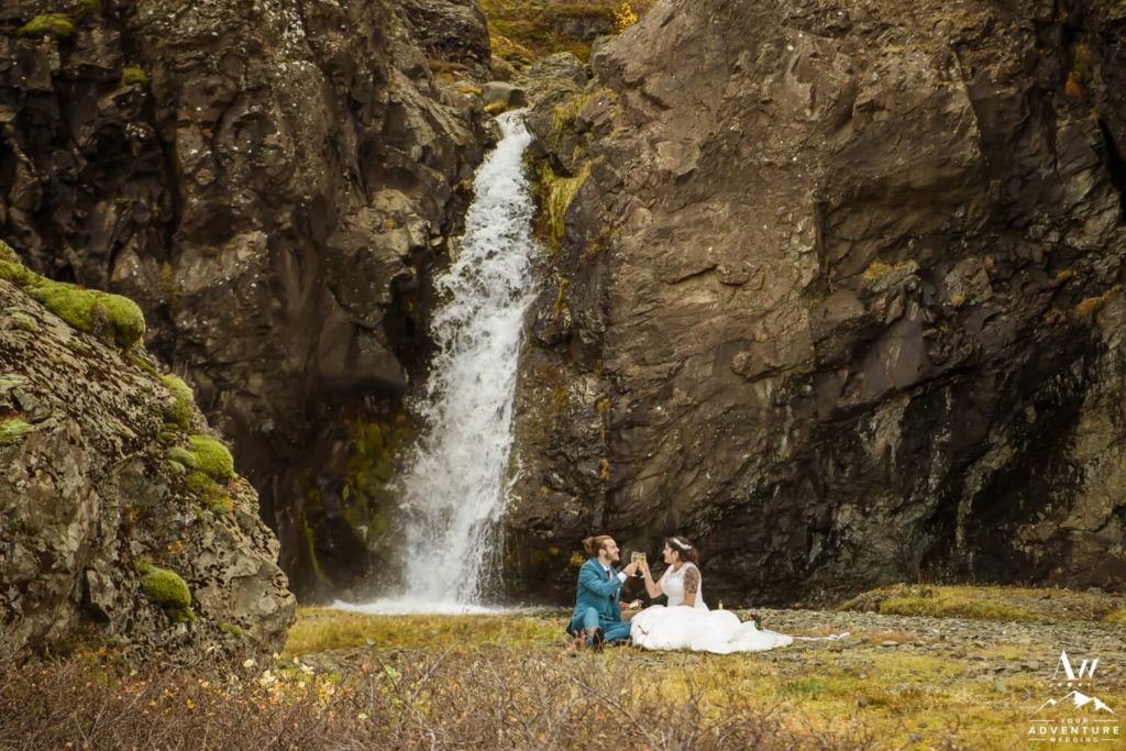 Adventure Elopement Couple having a picnic at a waterfall
