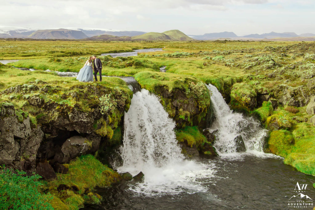 Adventure elopement couple ontop of a waterfall in Iceland