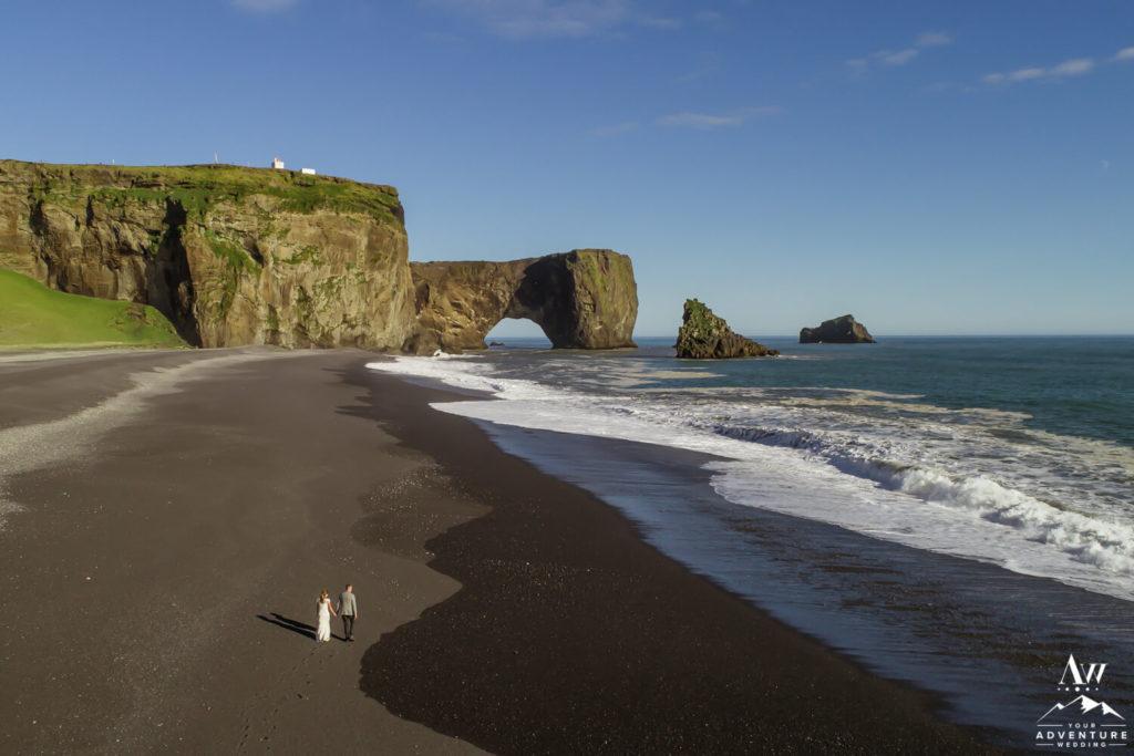 Iceland Elopement Couple walking on black sand beach