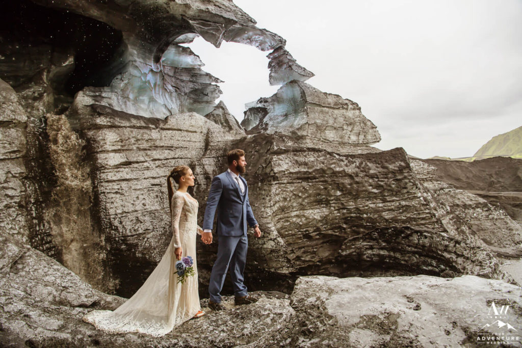 Iceland elopement couple beside ice arches
