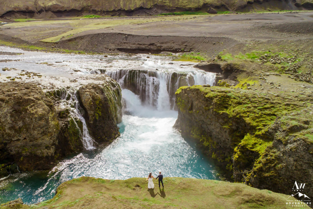 Drone Wedding Photo of Couple at a Waterfall