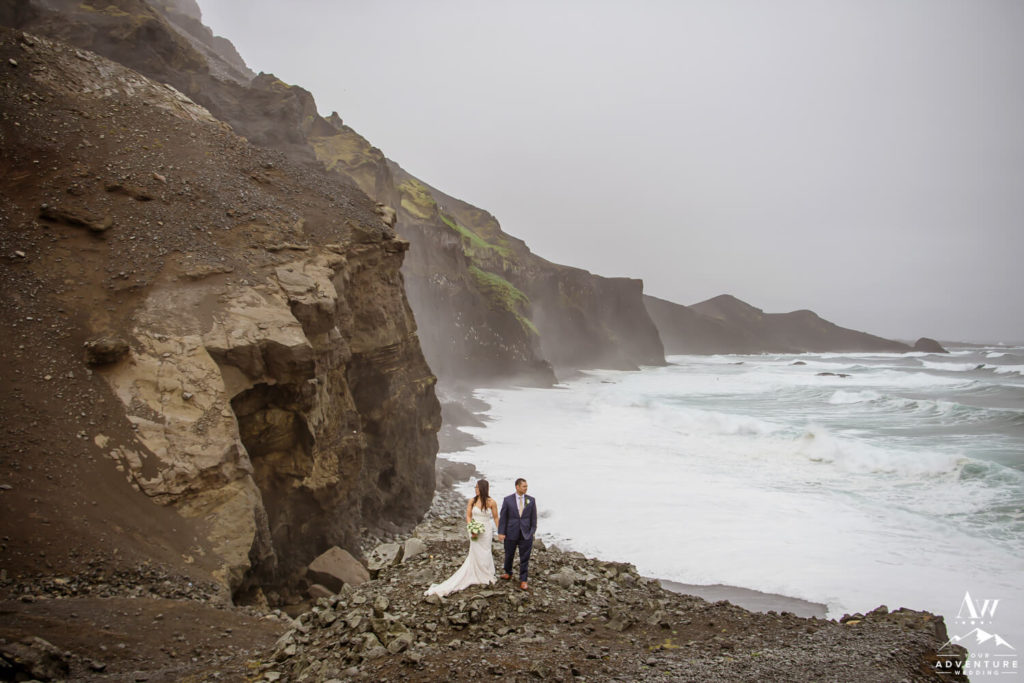 Couple standing in the rain in Iceland