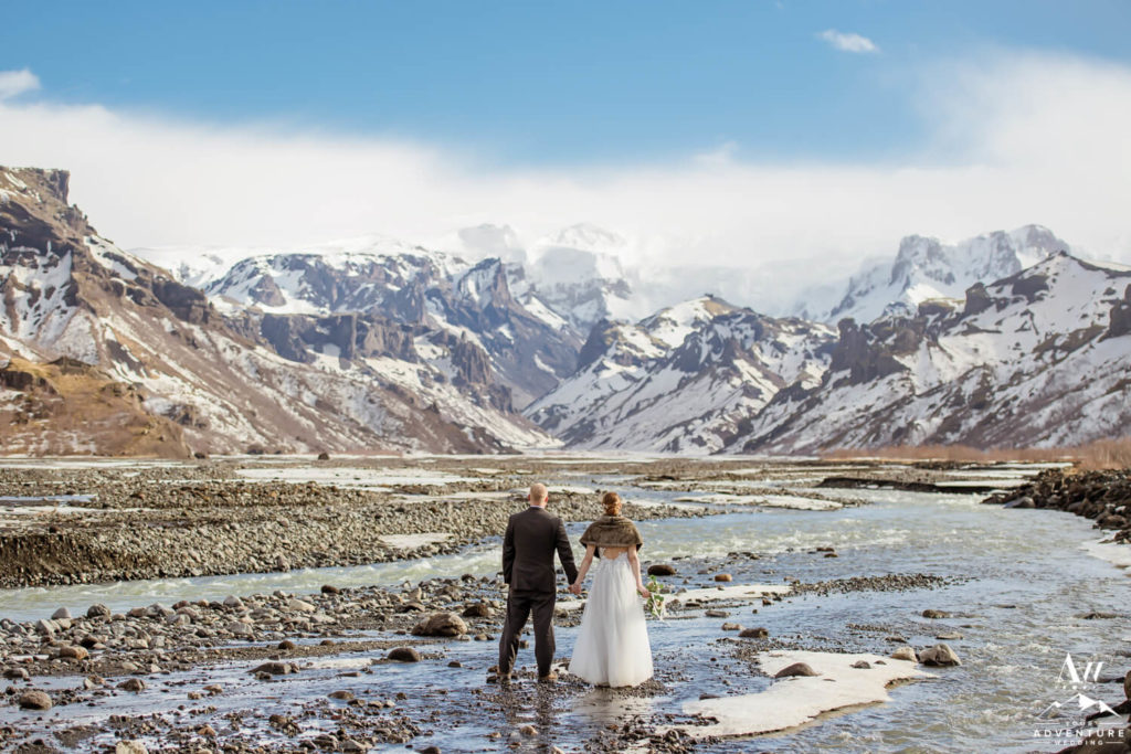 Iceland Wedding Couple standing in front of mountains in March
