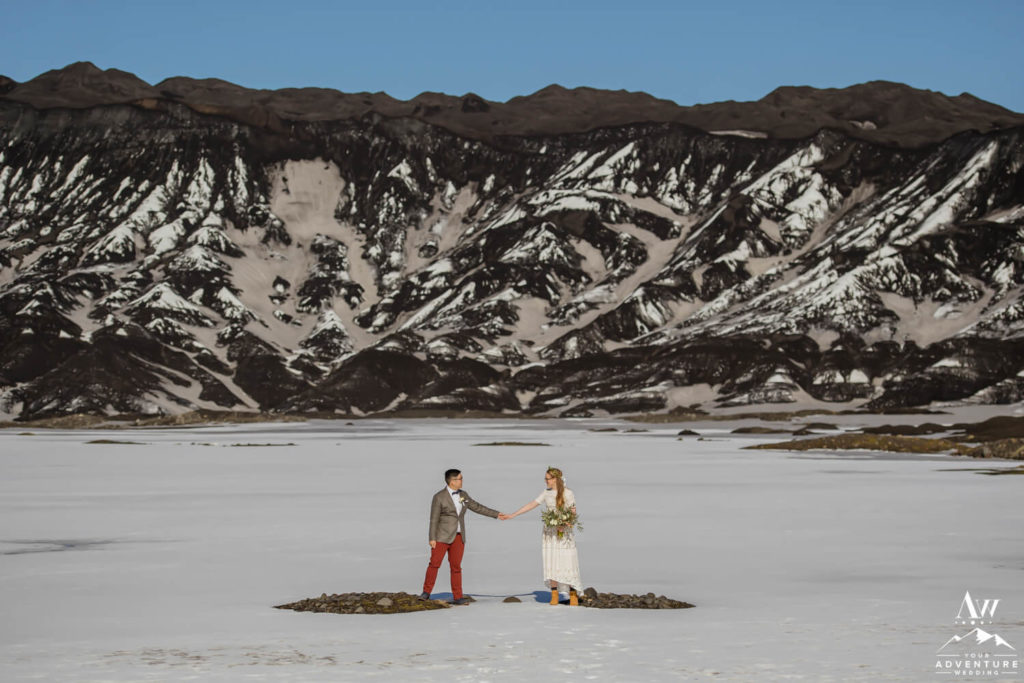 Iceland Elopement Couple in front of a black glacier