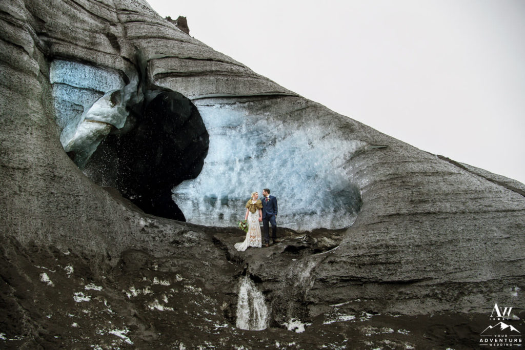 Couple in front of an ice cave in Iceland