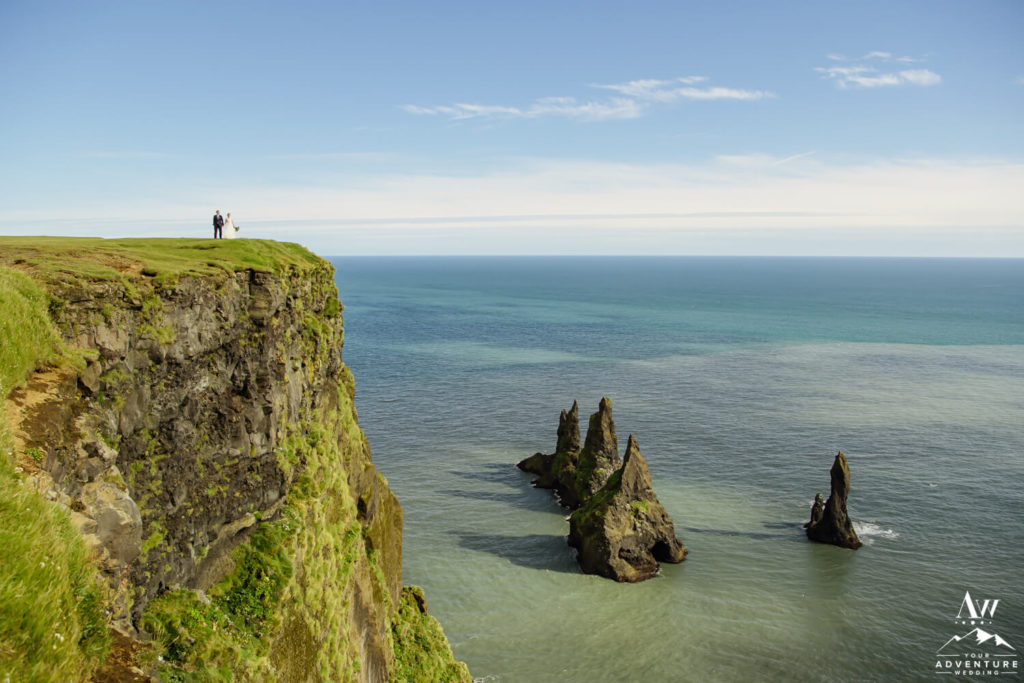 Adventure Elopement Couple Standing on a Cliff in Iceland