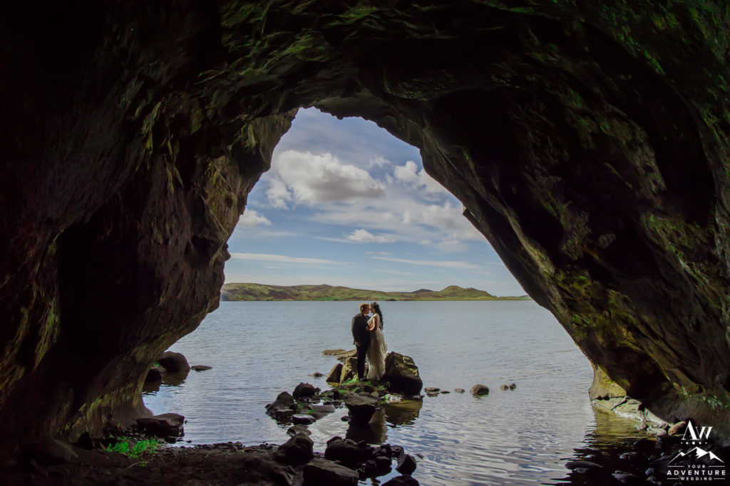 Couple kissing in a cave in Iceland