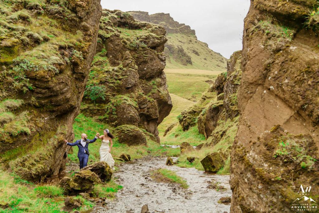 Iceland Wedding Couple Running through a Canyon