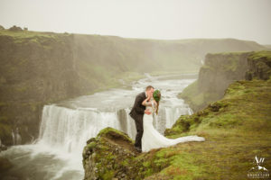 Couple kissing at a waterfall in Iceland