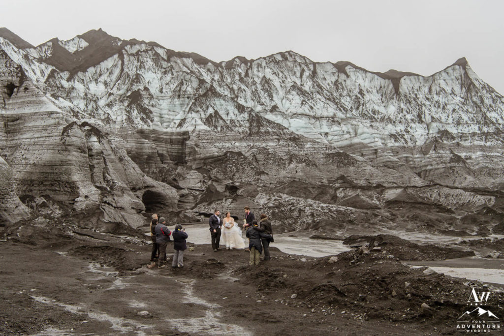 Iceland Wedding Couple married at a blakc glacier