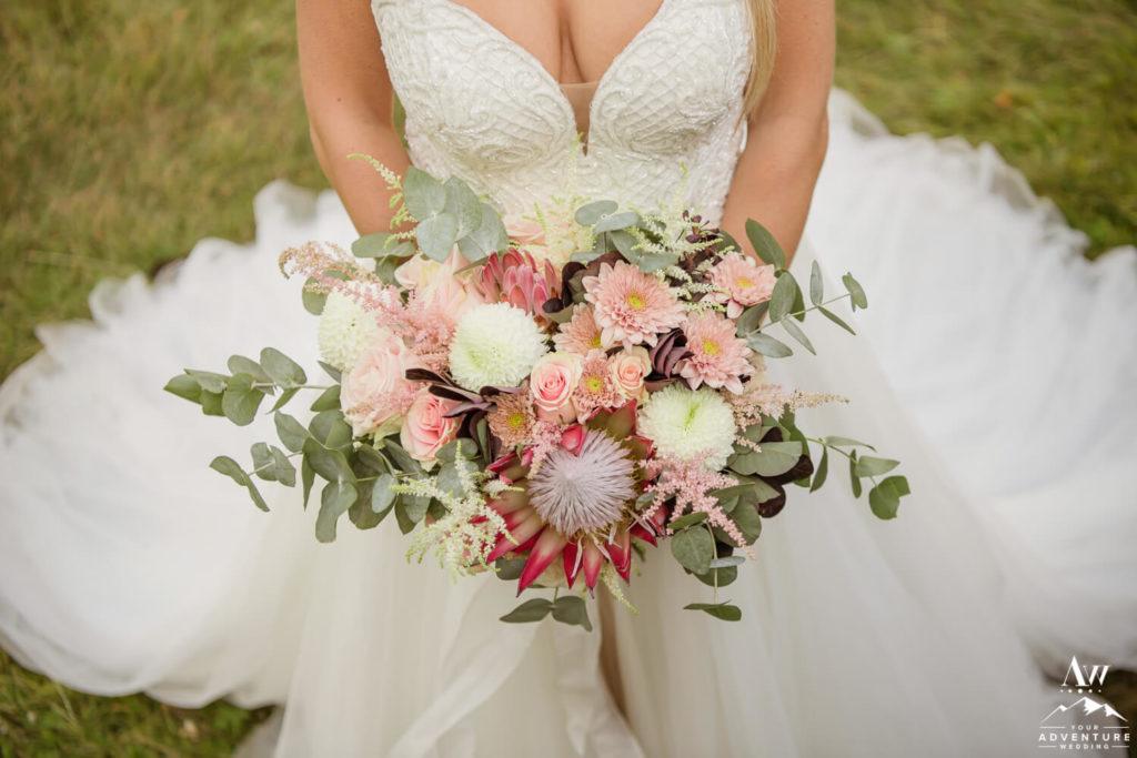 Bride Holding Adventure Elopement Bouquet