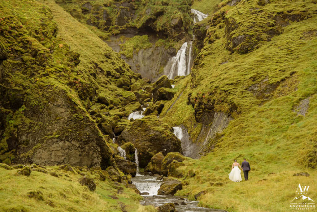 Couple in front of a waterfall in Vik