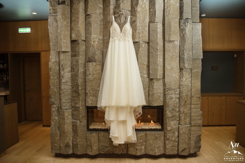 Iceland wedding dress hanging over a fireplace at Hotel Vik