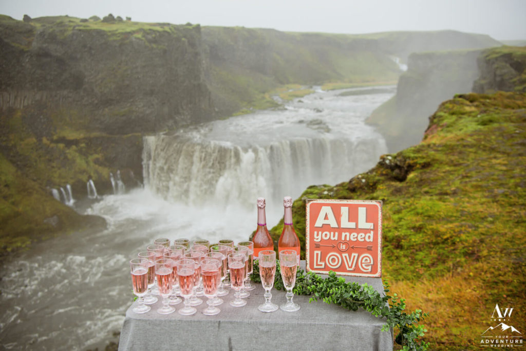 Iceland Wedding Champagne Toast in front of a waterfall
