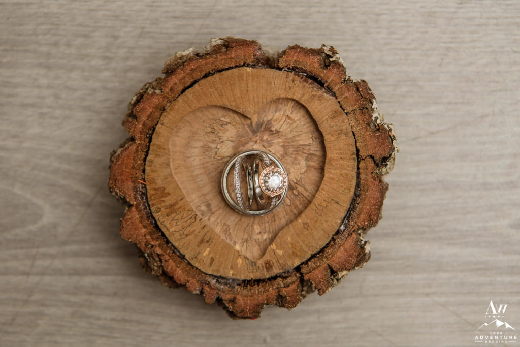 Iceland Wedding Rings in a Wood Heart