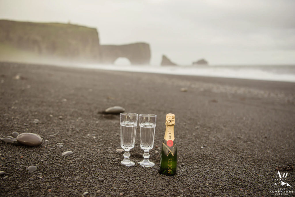 Champagne toast on black beach in Iceland