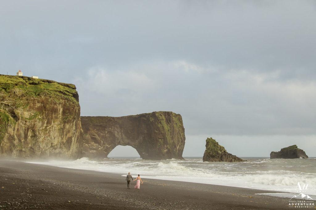 Iceland Elopement Couple walking on black beach