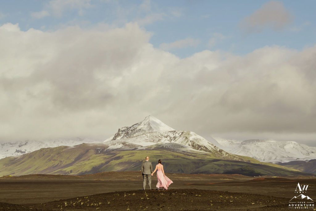 Daring Elopement Couple in front of a mountain