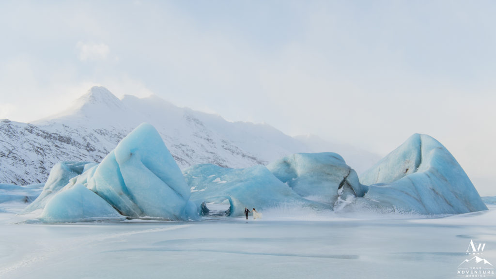 Couple in front of a floating iceberg